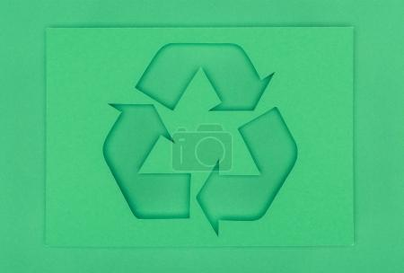top view of green recycle sign with arrows