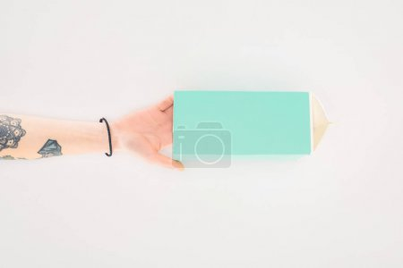 cropped shot of woman holding cardboard milk package isolated on white