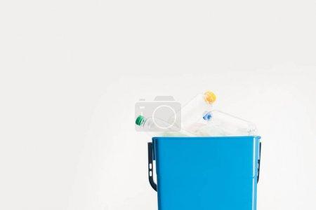 plastic bottles in trash bin isolated on white