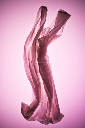 empty crumpled plastic bag under pink toned light