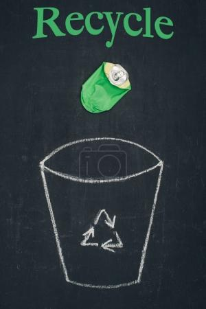beer can falling into drawn trash bin with recycle sign on chalkboard