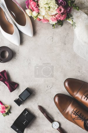 top view of wedding accessories on gray tabletop