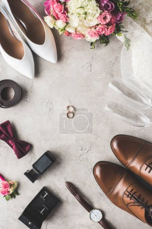 top view of wedding accessories on gray surface