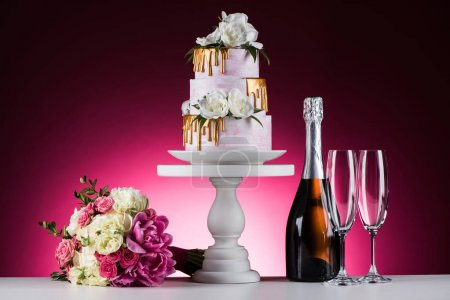 wedding bouquet, cake and champagne on pink