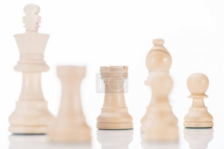 white chess king, rooks, bishop and pawns on white