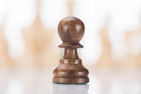 wooden chess pawn on chessboard, business concept