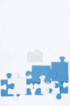 top view of white and blue puzzles isolated on white, business concept