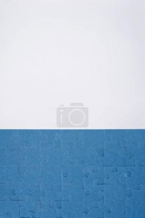 Photo for Top view of blue assembled puzzles isolated on white, business concept - Royalty Free Image