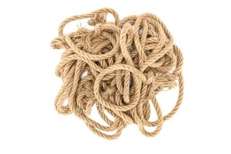 top view of brown nautical ropes with knots isolated on white