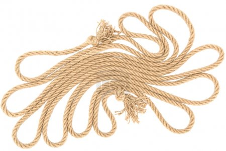 top view of arranged brown nautical rope with knots isolated on white