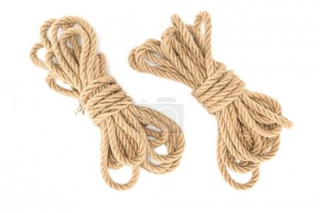 top view of arranged tied nautical ropes isolated on white
