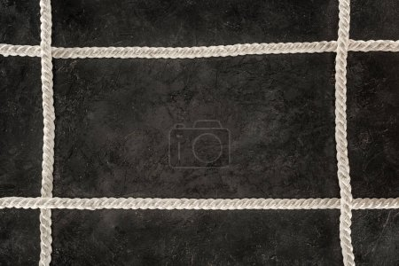top view of arranged white marine ropes on dark concrete tabletop