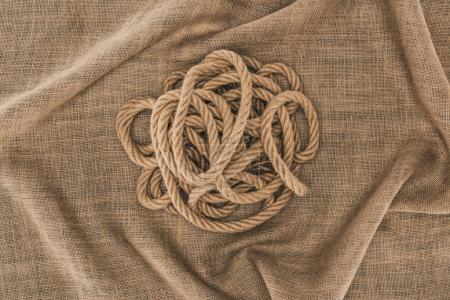 top view of arranged brown nautical rope on sackcloth