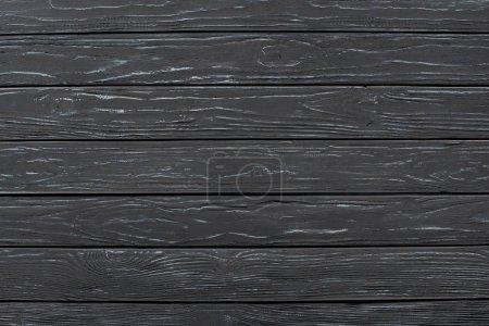 full frame of empty dark wooden backdrop