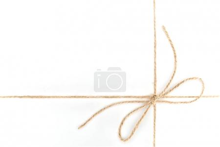close up view of bow made of brown rope isolated on white