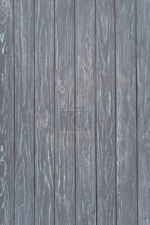 Wooden fence planks background painted in grey