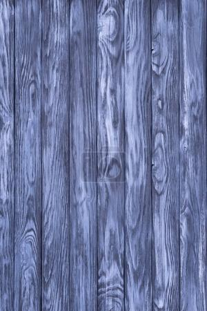 Wooden fence planks background painted in blue