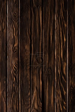 Wooden fence planks background painted in bronze color