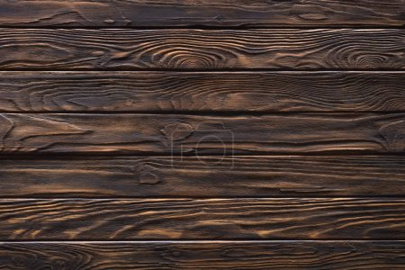 Wooden horizontal planks painted in brown background
