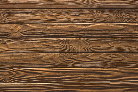 Wooden fence horizontal planks background painted in brown