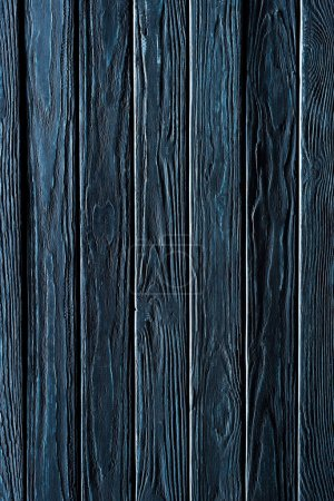 Wooden vertical planks painted in blue background