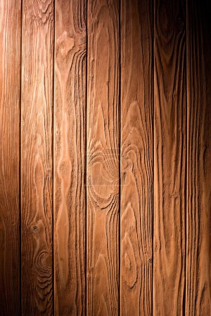 Wooden fence planks background painted in brown