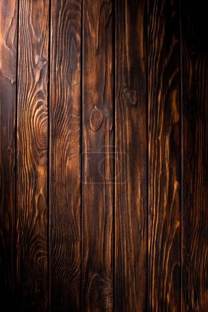 Photo for Wooden planks painted in brown background - Royalty Free Image