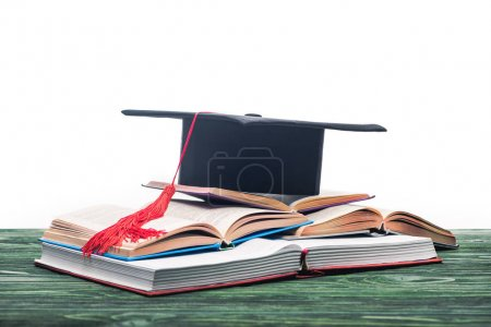 Open books with graduation cap on top