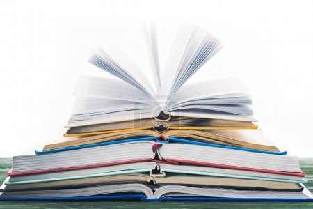 Photo for Stack of open books on wooden table - Royalty Free Image