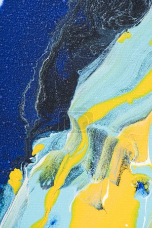Abstract colored background with yellow and blue acrylic paint