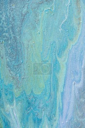 close up of abstract background with light blue acrylic paint