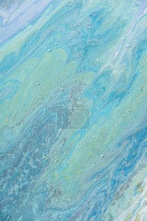 close up of abstract texture with light blue acrylic paint