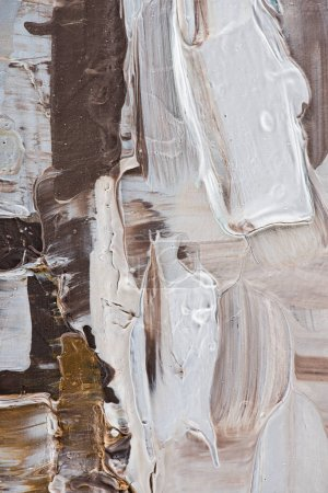 close up of beige and brown brush strokes of oil paint