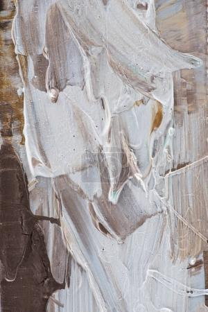 creative background with beige and brown brush strokes of oil paint