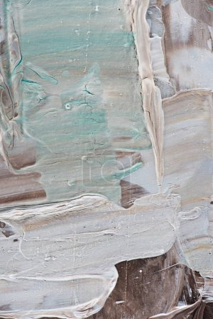 abstract creative background with beige and light blue brush strokes of oil paint