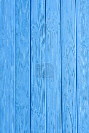 full frame image of wooden planks and blue background