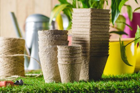 closeup shot of stacks of different flower pots on grass