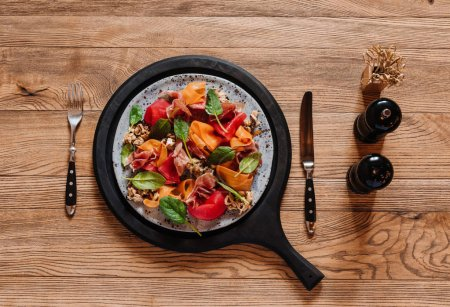 top view of delicious salad with mussels and vegetables on wooden table