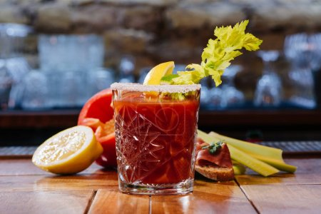 bloody mary cocktail in glass on wooden table