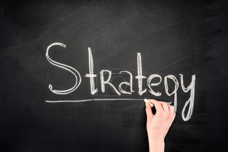 Hand writing Strategy underlined inscription on chalkboard