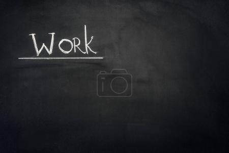 Photo for Work underlined inscription on dark chalkboard - Royalty Free Image