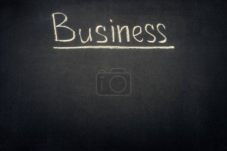 Photo for Business underlined inscription on dark chalkboard - Royalty Free Image