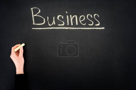 Hand writing Business underlined inscription on chalkboard