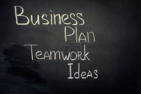 Photo for Business plan and teamwork ideas inscription on black chalkboard - Royalty Free Image