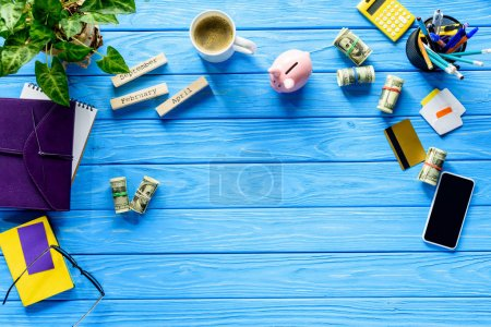 Business concept with money and stationery on blue wooden table