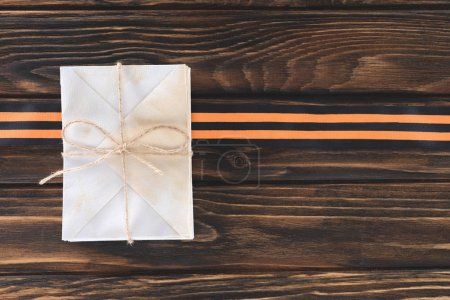top view of box wrapped by string and st george ribbon on wooden planks