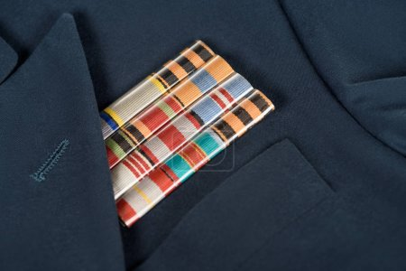 closeup shot of medals on navy blue jacket, victory day concept