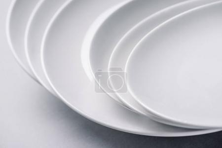 Photo for White ceramic plates stacked on white background - Royalty Free Image