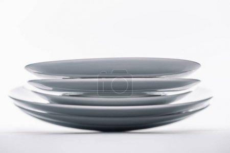 Stack of white porcelain plates on white background