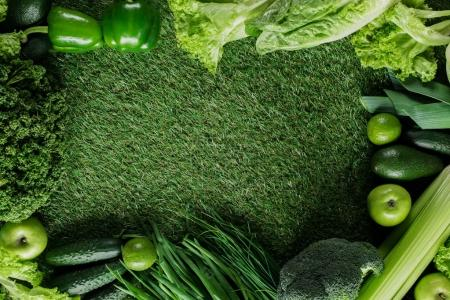 Photo for Top view of green vegetables on grass, healthy eating concept - Royalty Free Image